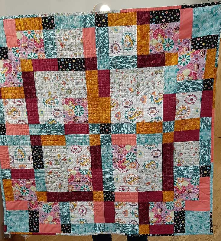 This is a disappearing 9 patch quilt made by Wendy.