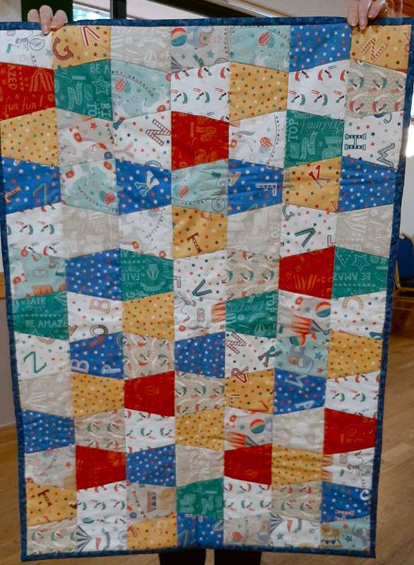 This quilt has been made by Jean using fabric won in the group raffle.
